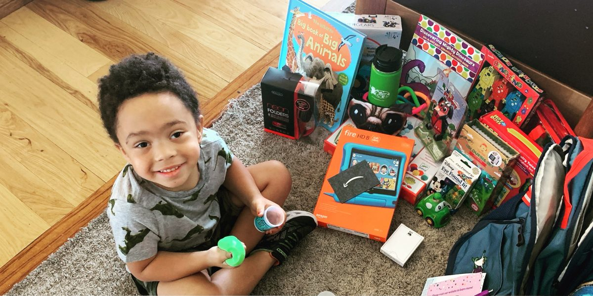 A photo of Miles with his bag and toys