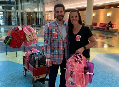 A photo of the Zimmermans at the hospital with bags to deliver
